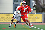 Baltimore, MD - March 3: Attackmen Eric Warden #5 of the Fairfield Stags drives toward the cage during the Fairfield v UMBC mens lacrosse game at UMBC Stadium on March 3, 2012 in Baltimore, MD.