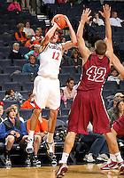 Nov 6, 2010; Charlottesville, VA, USA; Virginia Cavaliers g Joe Harris (12) shoots over Roanoke College f Joey Leech (42) Saturday afternoon in exhibition action at John Paul Jones Arena. The Virginia men's basketball team recorded an 82-50 victory over Roanoke College.
