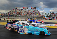 Mar. 9, 2012; Gainesville, FL, USA; NHRA funny car driver Tim Wilkerson (near lane) races alongside Bob Tasca III during qualifying for the Gatornationals at Auto Plus Raceway at Gainesville. Mandatory Credit: Mark J. Rebilas-