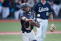 Liberty Flames catcher Gray Betts (2) makes a throw to first base against the Bellarmine Knights at Liberty Baseball Stadium on March 9, 2021 in Lynchburg, VA. (Brian Westerholt/Four Seam Images)