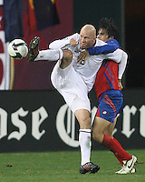 Conor Casey #8 of the USA pushes the ball away Cristian Montero #16 of Costa Rica during a 2010 World Cup qualifying match in the CONCACAF region at RFK Stadium on October 14 2009, in Washington D.C.The match ended in a 2-2 tie.