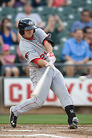 Firstbaseman Koby Clemens #21 of the Oklahoma City RedHawks hits a home run against the Round Rock Express on April 26, 2011 at the Dell Diamond in Round Rock, Texas. (Photo by Andrew Woolley / Four Seam Images)