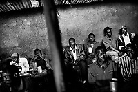 Men in Kibera drinking a local brew called busaa in the Railway Busaa Club.