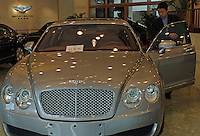 Buyers in the the Bentley showroom in Beijing, China. The luxury cars that retail for around 3 million RMB each are in short supply on the mainland with all cars being bought-up. This showroom sold more than 30 cars last year. .05 Feb 2006