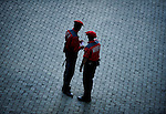 Two police officers speak before the sixth San Fermin Festival bull run of Victorinano del Rio Cortes's bulls, on July 12, 2012, in Pamplona, northern Spain. The festival is a symbol of Spanish culture that attracts thousands of tourists to watch the bull runs despite heavy condemnation from animal rights groups. (c) Pedro ARMESTRE
