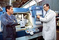 - worker in the Tacchella Rectifying factory....- operaio nella fabbrica Rettificatrici Tacchella