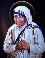 tapestry with a portrait of Mother Teresa in St Peter's square at the Vatican. Pope Francis during the hearing catechism with nuns of the Missionary of Charity, the Religious family founded by Mother Teresa. in St Peter's square at the Vatican on September 3, 2016