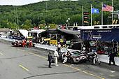 #86 Michael Shank Racing with Curb-Agajanian Acura NSX, GTD: Katherine Legge, Alvaro Parente , #48 Paul Miller Racing Lamborghini Huracan GT3, GTD: Madison Snow, Bryan Sellers pit stops.