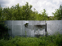 Shrapnel marks on a metal fence in a residenial area of Marinka which according to Ukrainian government forces was a result of mortar fire from Russian-backed separatists from the positions they hold closeby.