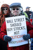 On the 1st Anniversary of The US Supreme Court Citizen's United v. Federal Election Commission 5-4 decision allowing unlimited corporate spending in elections as free speech citizens protest outside the Federal Courthouse in Boston MA 1.22.12