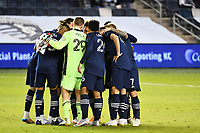 KANSAS CITY, KS - OCTOBER 24: Sporting KC players in a pre match huddle during a game between  at Children's Mercy Park on October 24, 2020 in Kansas City, Kansas.