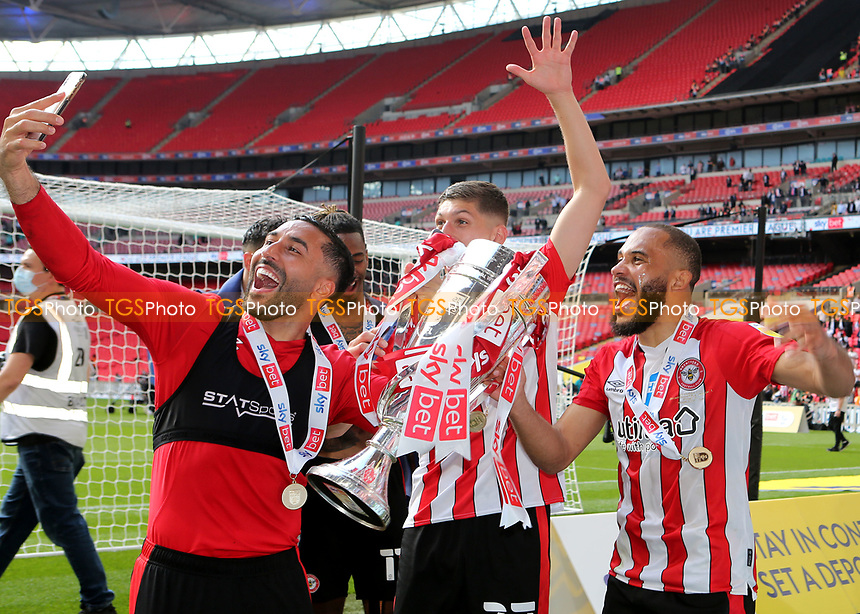 Saman Ghoddos, Vitaly Janelt and Bryan Mbeumo of Brentford celebrate winning the Championship Play-Off Final during Brentford vs Swansea City, Sky Bet EFL Championship Play-Off Final Football at Wembley Stadium on 29th May 2021