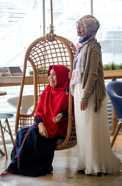 23 JAN, 2018, Jakarta, Indonesia: Irna Mutiara (48, seated) founder of Islamic Fashion Institute with Marina Kuswa (30) an alumni and one of the first Institute students discussing the rise of Islamic fashion and the massive revenue boost the sector is bringing to the Indonesian economy and individual designers and industry as a whole. Pictured in Jakarta by Graham Crouch for Luzerner Zeitung