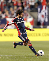 New England Revolution substitute midfielder Juan Toja (18) passes the ball. Despite a red-card man advantage, in a Major League Soccer (MLS) match, the New England Revolution tied New York Red Bulls, 1-1, at Gillette Stadium on September 22, 2012.