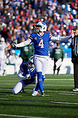 Buffalo Bills Stephen Hauschka (4) kicks an extra point as Matt Darr (8) holds during an NFL football game against the New York Jets, Sunday, December 9, 2018, in Orchard Park, N.Y.  (Mike Janes Photography)