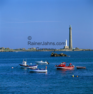 France, Brittany, near Plouguerneau: Fishing boats in front of Phare de la Vierge Lighthouse, Europe's highest lighthouse