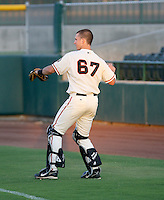 Buster Posey / AZL Giants warms up the pitcher before an AZL game at Scottsdale Stadium - 08/24/2008..Photo by:  Bill Mitchell/Four Seam Images
