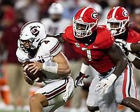 ATHENS, GA - SEPTEMBER 18: Quay Walker #7 sacks Luke Doty #4 but grabs the facemask before a game between South Carolina Gamecocks and Georgia Bulldogs at Sanford Stadium on September 18, 2021 in Athens, Georgia.