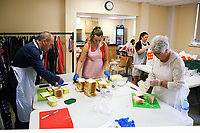 Pictured L-R: Deputy Council Leader Clive Lloyd, Linzi Isaac and Cynthia Lloyd prepare cheese sandwiches at Jersey Park Pavilion in Swansea, UK. Friday 25 August 2017<br /> Re: Free food for children story, Swansea, Wales, UK.