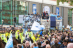 © Joel Goodman - 07973 332324  . 23/05/2011 . Manchester, UK . Tens of thousands of fans line the streets of Manchester as Manchester City Football Club hold an open-topped bus parade through the city. The team are celebrating winning the FA Cup, their first trophy in 35 years, and for qualifying for next season's Champions League . Photo credit: Joel Goodman