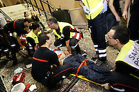 Switzerland. Canton Neuchâtel. Neuchâtel. Grape Harvest Festival. Medical care. A group of men, firemen and ambulance men, working for the SIS ( Service Incendie Secours) Neuchâtel, give the first aid to a young man who is in a ethylic coma due to an abuse of alcohol. The unconscious boy is laid on a stetcher and is rushed to the hospital. Night life. © 2006 Didier Ruef
