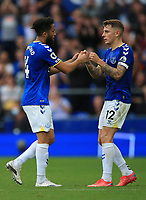 25th September 2021; Goodison Park, Liverpool, England; Premier League football, Everton versus Norwich; Andros Townsend of Everton bumps fits with team mate Lucas Digne of Everton