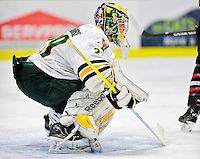 26 November 2010: University of Vermont Catamount goaltender Rob Madore, a Junior from Pittsburgh, PA, in first period action against the Northeastern University Huskies at Gutterson Fieldhouse in Burlington, Vermont. The Huskies and Catamounts battled to a 2-2 tie. Mandatory Credit: Ed Wolfstein Photo
