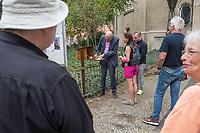 Eroeffnung der ersten Stempelstation fuer den Jakobsweg in Berlin an der Koenigin-Luise-Gedaechtniskirche in Berlin Schoeneberg.<br /> Zur Eroeffnung kamen neben etlichen Pilgern aus Deutschland auch die Berliner Imamin Seran Ates.<br /> Im Bild: Joerg Superintendent Michael Raddatz vom Berliner evangelischen Kirchenkreis Tempelhof-Schoeneberg (links im Bild) stempelt angereisten Pilgern ihren Pilgerpass.<br /> 24.8.2020, Berlin<br /> Copyright: Christian-Ditsch.de<br /> NUR FUER REDAKTIONELLE ZWECKE! Werbung nur auf Anfrage beim Fotografen. [Inhaltsveraendernde Manipulation des Fotos nur nach ausdruecklicher Genehmigung des Fotografen. Vereinbarungen ueber Abtretung von Persoenlichkeitsrechten/Model Release der abgebildeten Person/Personen liegen nicht vor. NO MODEL RELEASE! Don't publish without copyright Christian-Ditsch.de, Veroeffentlichung nur mit Fotografennennung, sowie gegen Honorar, MwSt. und Beleg. Konto: I N G - D i B a, IBAN DE58500105175400192269, BIC INGDDEFFXXX, Kontakt: post@christian-ditsch.de<br /> Bei der Bearbeitung der Dateiinformationen darf die Urheberkennzeichnung in den EXIF- und  IPTC-Daten nicht entfernt werden, diese sind in digitalen Medien nach §95c UrhG rechtlich geschuetzt. Der Urhebervermerk wird gemaess §13 UrhG verlangt.]