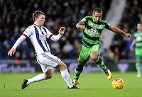 Wayne Routledge of Swansea City and Craig Gardner of West Bromwich Albion during the Barclays Premier League match between West Bromwich Albion and Swansea City at The Hawthorns on the 2nd of February 2016