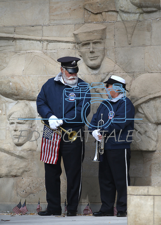 Ray Ahrenholz and Mary Sedgwick, with Buglers Across America, participate in the Pearl Harbor 75th Commemoration at the U.S.S. Nevada memorial at the Capitol in Carson City, Nev. on Wednesday, Dec. 7, 2016. <br /> Photo by Cathleen Allison/Nevada Photo Source