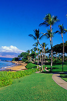 Couples walk along Ulua Beach near the Wailea Marriott Resort. This is a popular walking and running path along Ulua, Makapu and Wailea Beaches, on the south side of the island.