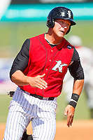 Kevan Smith #32 of the Kannapolis Intimidators rounds third base against the Hickory Crawdads at CMC-Northeast Stadium on April 8, 2012 in Kannapolis, North Carolina.  The Intimidators defeated the Crawdads 12-11.  (Brian Westerholt/Four Seam Images)