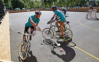 17 AUG 2014 - LONDON, GBR - A player attempts to retain control of the ball during the 2014 London Open Bike Polo tournament in Highbury Fields in London, Great Britain (PHOTO COPYRIGHT © 2014 NIGEL FARROW, ALL RIGHTS RESERVED)