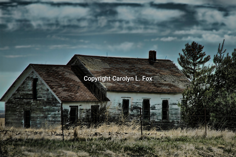An old house sits in a pasture in Mid-America.