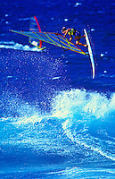 Windsurfers perform at world famous Hookipa beach, on Maui.