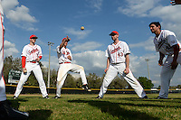 Ball State Cardinals T.J. Baker (16), David Current (32), Devin Wilburn (43) and Anthony Gomez (45) play two ball before a game against the Maine Black Bears on March 3, 2015 at North Charlotte Regional Park in Port Charlotte, Florida.  Ball State defeated Maine 8-7.  (Mike Janes/Four Seam Images)