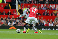 Pictured L-R: Wilfried Bony of Swansea against Chris Smalling of Manchester United. Saturday 16 August 2014<br /> Re: Premier League Manchester United v Swansea City FC at the Old Trafford, Manchester, UK.