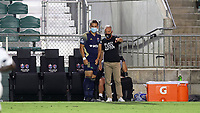 CARY, NC - AUGUST 01: Dave Sarachan gives instructions to Ben Speas #17 for putting subbing him in during a game between Birmingham Legion FC and North Carolina FC at Sahlen's Stadium at WakeMed Soccer Park on August 01, 2020 in Cary, North Carolina.