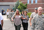 Workers are evacuated during an active shooter drill at the Adjutant General complex in Carson City, Nev., on Wednesday, July 22, 2015. Nevada National Guard, Carson City Sheriff and Fire departments and Nevada Division of Emergency Management were all part of the exercise. <br /> Photo by Cathleen Allison