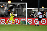LAKE BUENA VISTA, FL - JULY 26: Tim Melia of Sporting KC saves a shootout attempt by Derek Cornelius of Vancouver Whitecaps FC during a game between Vancouver Whitecaps and Sporting Kansas City at ESPN Wide World of Sports on July 26, 2020 in Lake Buena Vista, Florida.