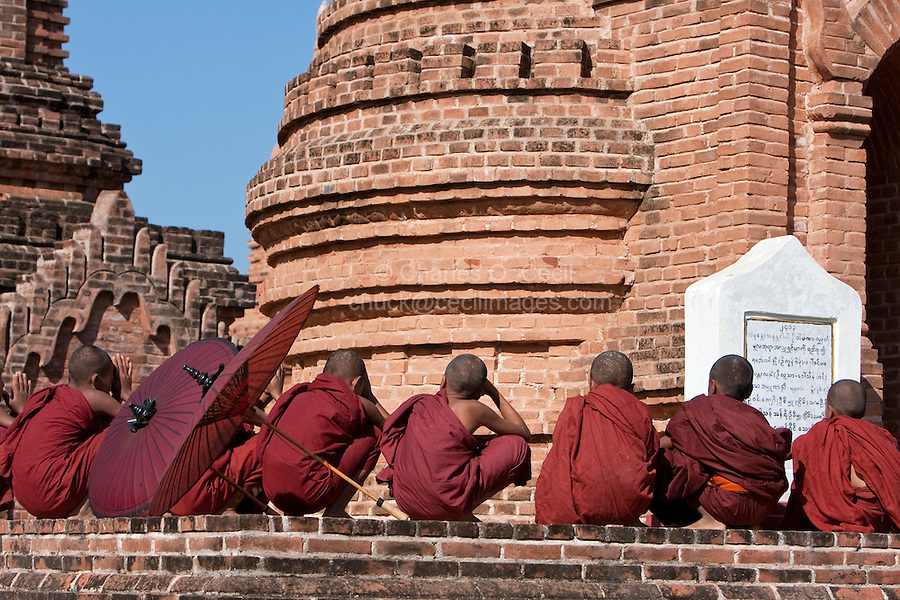 Myanmar, Burma. Bagan.  Young Novice Monks Waiting Outside Temple.