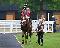 Winner of The Swallowcliffe Handicap (Div 1) Burguillos  ridden by Eoin Walsh and trained by Luke McJannet is led into the Winners enclosure during Horse Racing at Salisbury Racecourse on 13th August 2020