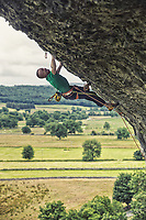 Neil Gresham on Freakshow 8c at Kilnesey, UK.<br /> The great brooding limestone cliff of Kilnsey is recognised as one of the UK's most impressive crags. Its most distinctive feature is an enormous roof that caps the already severely overhanging South Buttress. This feature was first aid climbed in the 50s but shot to prominence in 1988 when it was freed by Mark Leach to give Mandela – so named as 'they said it would never go free'. This summer Neil Gresham added his own take on Kilnsey Main Overhang but at a much higher grade with his route Freakshow. 8c in difficulty Freakshow is very different to your typical British sport route – almost 40m in length and with 18 clips the route climbs like the Spanish ultra endurance routes currently defining modern sport climbing. Success for Neil came after 14 days of effort.