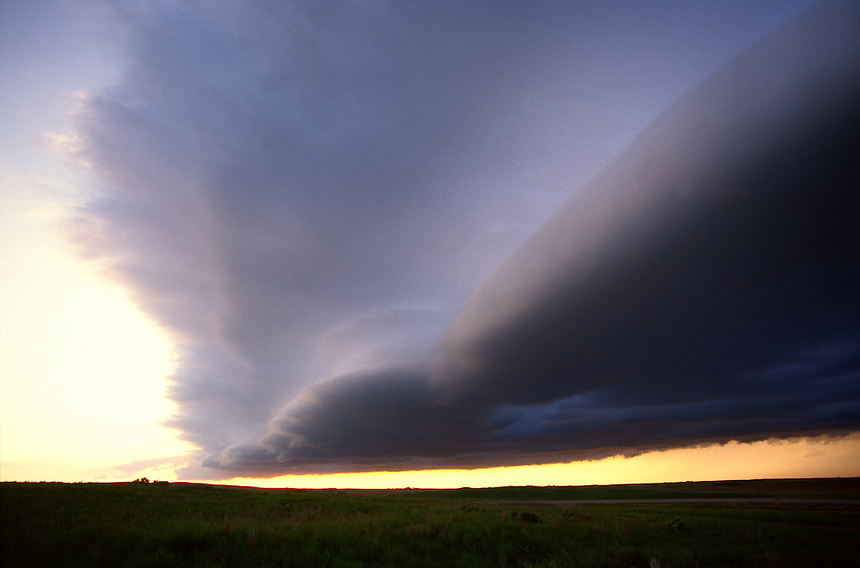 A laminar arcus cloud drifts slowly southward over open ranchland in central Nebraska after the passage of a severe thunderstorm in June.