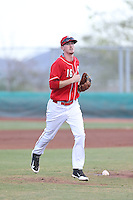 Blake Butler (16) of the AZL Reds returns to the dugout during a game against the AZL Brewers at Cincinnati Reds Spring Training Complex on July 5, 2015 in Goodyear, Arizona. Reds defeated the Brewers, 9-4. (Larry Goren/Four Seam Images)