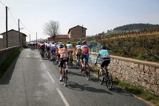 The peloton passes through the vineyards on Mont Brouilly during Stage 4 of Paris-Nice 2021, running 187.5km from Chalon-sur-Saone to Chiroubles, France. 10th March 2021.<br /> Picture: ASO/Fabien Boukla | Cyclefile<br /> <br /> All photos usage must carry mandatory copyright credit (© Cyclefile | ASO/Fabien Boukla)