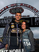 Aug 31, 2014; Clermont, IN, USA; NHRA pro stock driver Vincent Nobile with sister Nicole Nobile during qualifying for the US Nationals at Lucas Oil Raceway. Mandatory Credit: Mark J. Rebilas-USA TODAY Sports