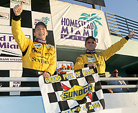Max Angelelli and Wayne Taylor celebrate after winning the Grand Prix od Miami at Homestead-Miami Speedway on Saturday, March 5, 2005.(Grand American Road Racing Photo by Brian Cleary)