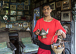 10 March 2015, Kandy, Sri Lanka: A waiter with a teapot and bread at the unusual boutique hotel Helga's Folly, owned by Helga Desilva Blow Perera, which is filled with art and memorabilia in Kandy, Central Province, Sri Lanka. Kandy is the second largest city in the country after Colombo. It was the last capital of the ancient kings' era of Sri Lanka. The city lies in the midst of hills in the Kandy plateau, which crosses an area of tropical plantations, mainly tea. Kandy is both an administrative and religious city and is also the capital of the Central Province. Kandy is the home of The Temple of the Tooth Relic (Sri Dalada Maligawa), one of the most sacred places of worship in the Buddhist world. It was declared a world heritage site by UNESCO in  1988. Picture by Graham Crouch for the New York Times