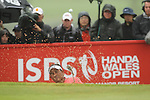 Tongchai Jaidee splashes out of the sand on the 16th hole during the final round of the ISPS Handa Wales Open 2012..03.06.12.©Steve Pope